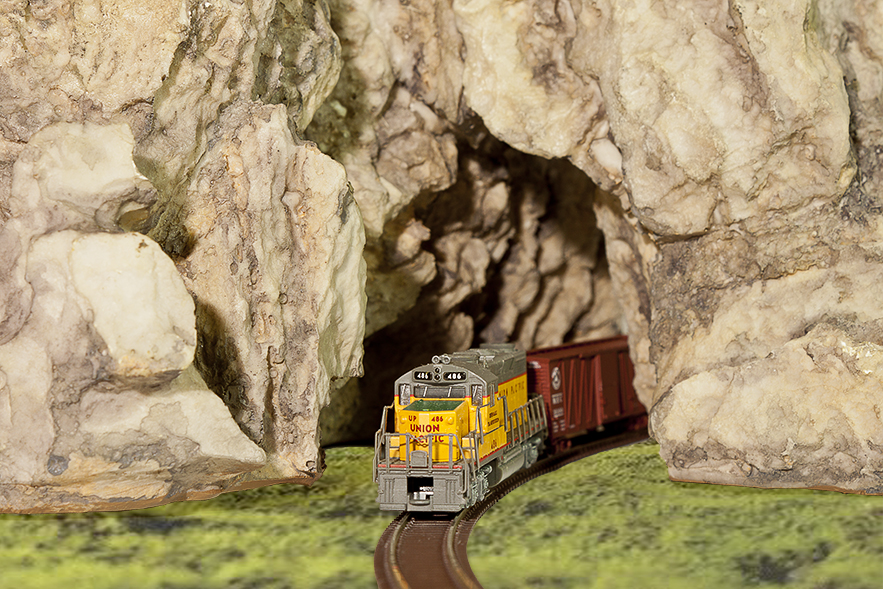 Close-up of N-scale train passing through tunnel on Craggy Summit (00947)